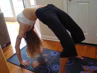 Woman doing Urdhva Dhanurasana yoga pose