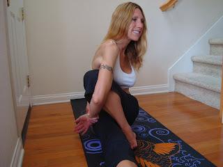 Woman doing Marichasana C yoga pose