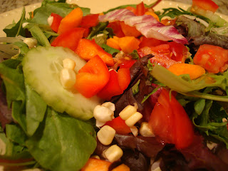 Green salad topped with mixed diced vegetables