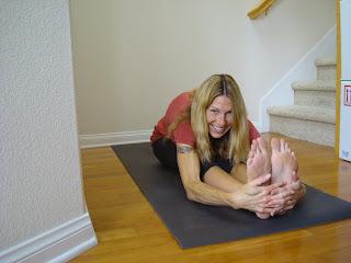 Woman doing seated forward bend yoga pose