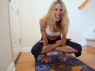 Woman doing Kukkutastana yoga pose