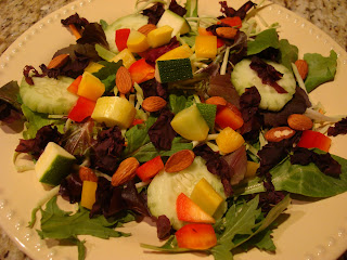 Greens with mixed vegetables and Dulse Flakes on white plate