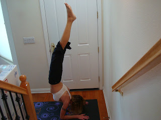 Woman doing Pincha Mayurasana yoga pose