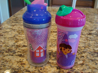 Children's sippy cups full of banana almond agave smoothies