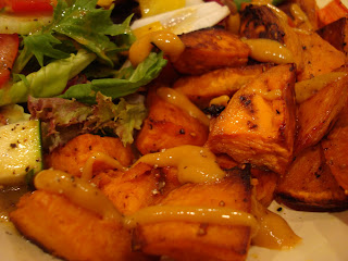 Roasted Sweet Potatoes and carrots drizzled with sweet hot mustard