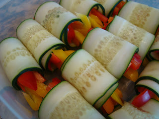 Close up of cucumber wraps in container