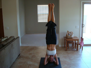 Woman doing headstand yoga pose