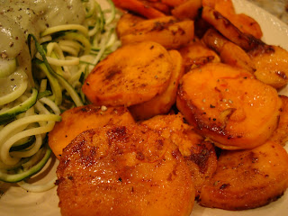 Roasted Sweet Potatoes and Carrots on plate close up next to spiralized zucchini noodles