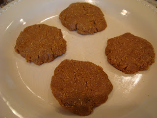 Blended ingredients formed into four cookies on white plate