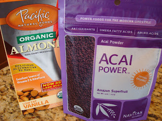 Container of Organic Almond Milk and Package of Acia Powder