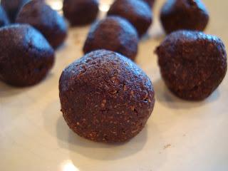 Close up of one Raw Vegan Chocolate Donut Hole