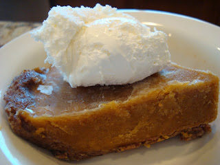 Side of Pumpkin Pie in white dish