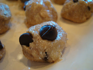 One Raw Vegan Chocolate Chip Cookie Dough Ball on white plate
