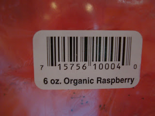 Barcode on raspberries showing 6 oz size and Organic Raspberry