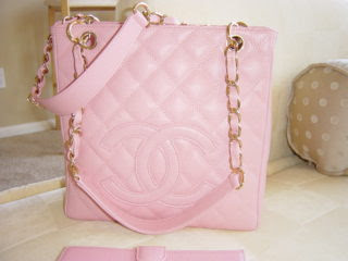Up close of pink Chanel bag with gold and pink handles