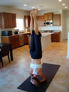 Woman doing Sirasana yoga pose