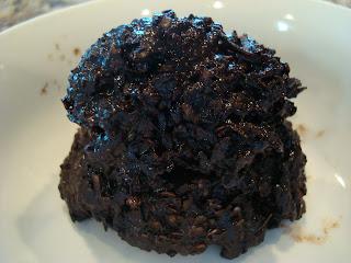 One vegan dark chocolate coconut snowball in shallow dish