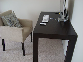Black desk with cream colored chair