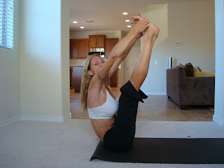 Woman doing Urdhva Muka Paschimottanasana yoga pose