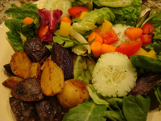 Mixed green salad with vegetables served with tri colored potatoes