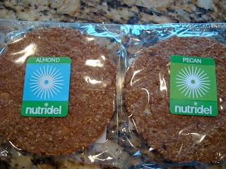 Two Nutridel cookies one almond one pecan flavor