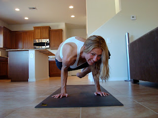 Woman doing Parsva Bakasana yoga pose