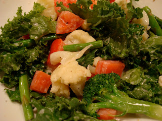 Kale Salad with Vegetables topped with homemade dressing