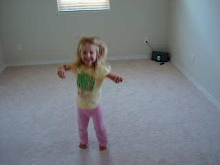 Young girl dancing to music in room