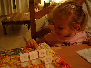 Little girl playing with advent calendar