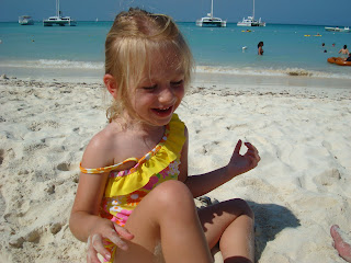 Young girl on beach playing in sand