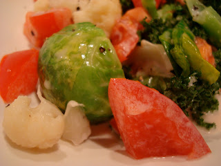 Up close of vegetables covered in dressing