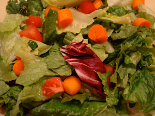 Mixed greens with sliced vegetables