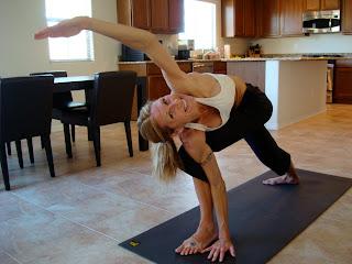 Woman doing Parivrtta Parsvakonasana yoga pose
