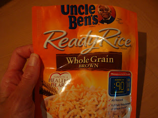 Uncle Bens Ready Rice Whole Grain Brown in package