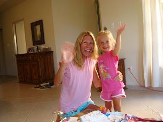 Young girl and woman waving