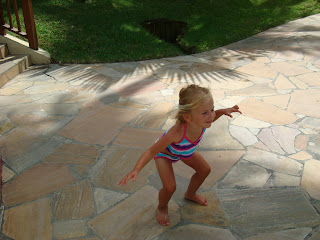 Young girl pretending to fly like a bird