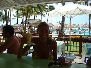 Woman sitting at outdoor bar with Pina Colada