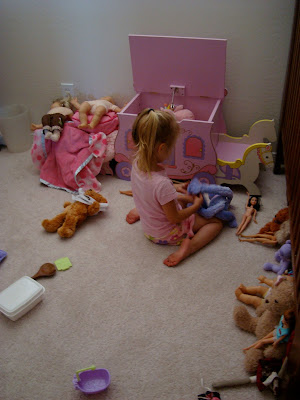 Backside of young girl playing with toys