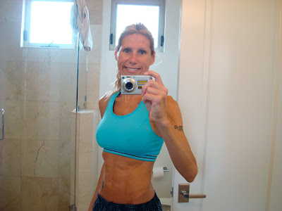 Woman taking photo in mirror in workout clothes