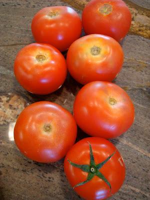Seven vine ripe tomatoes
