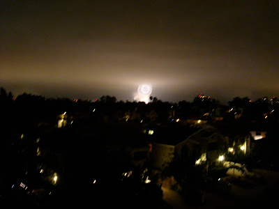 White large firework going off in distance