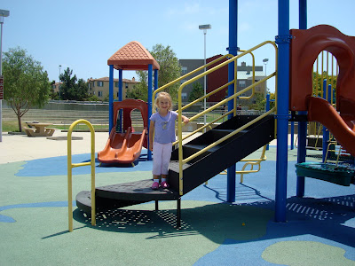 Young girl on playground equipment