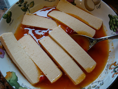 Sliced up tofu in marinade