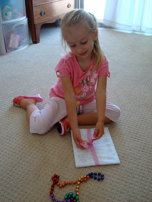 Young girl sitting on floor opening gift