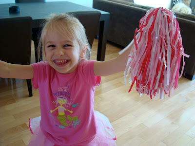 Close up of young girl holding pompoms