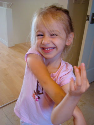 Child crossing arms and smiling