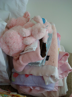 Stack of blanket and baby toys