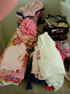 Piles of children's clothing