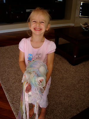 Young girl on pony smiling