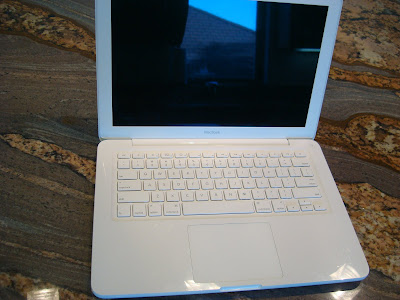 White macbook open
